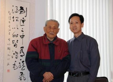 2009年中國禅林畫院紐約首次畫展上,中國禅林畫院院長李智隆與名譽院長丁兆麟先生合影。